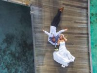 photo-of-bride-and-groom-laying-on-pier-1034356