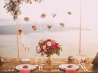 pink-and-red-roses-centerpiece-near-silverwares-1045541