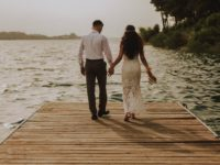 photo-of-couple-standing-on-wooden-planks-2403568